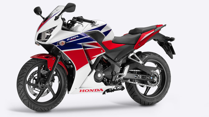 Side facing Honda motorcycle with red, white and blue livery.