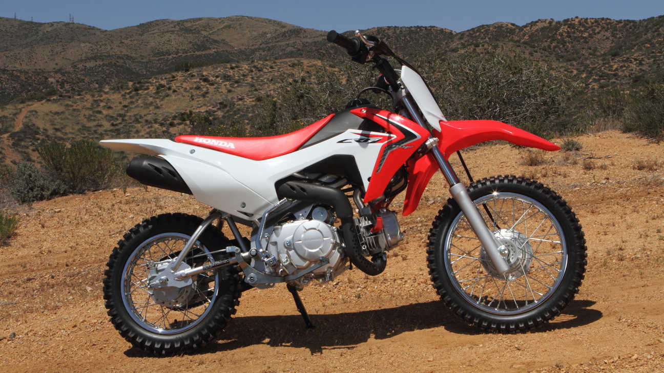 Side-on view of CRF110F, off-road location.
