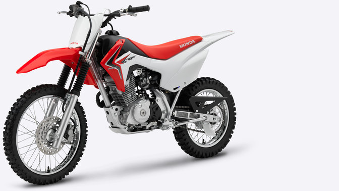 Side, 3-quarter view of red CRF125F, left facing.