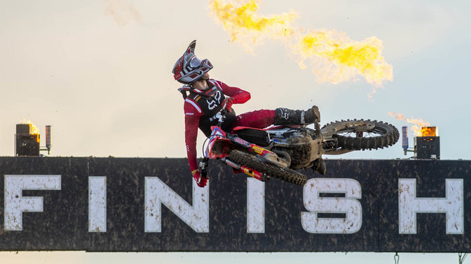 Honda MXGP rider in the air at the finish line.