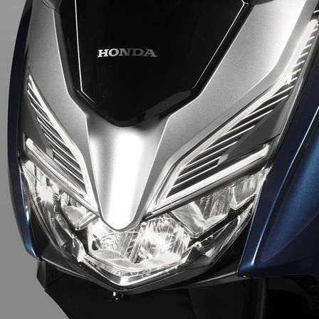 Close up of Honda Forza 300 LED headlights.