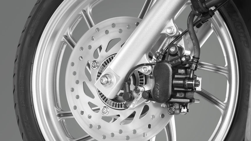 Close-up of front wheel showing CBS brakes.
