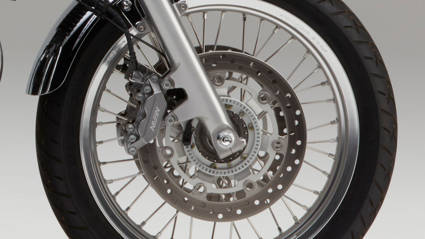 Close up shot of Honda CB1100 EX wheel and brake disc.