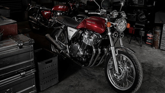 Honda CB1100 EX on stand in workshop.