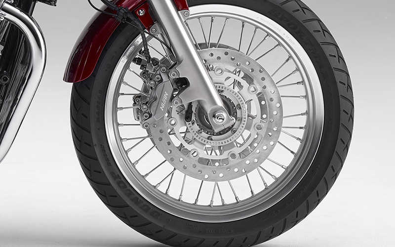 Close up shot of Honda CB1100EX wheel and brake disc.