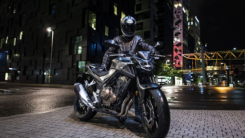 CB500F, 3-quarter front right side, parked in an urban landscape at night with rider