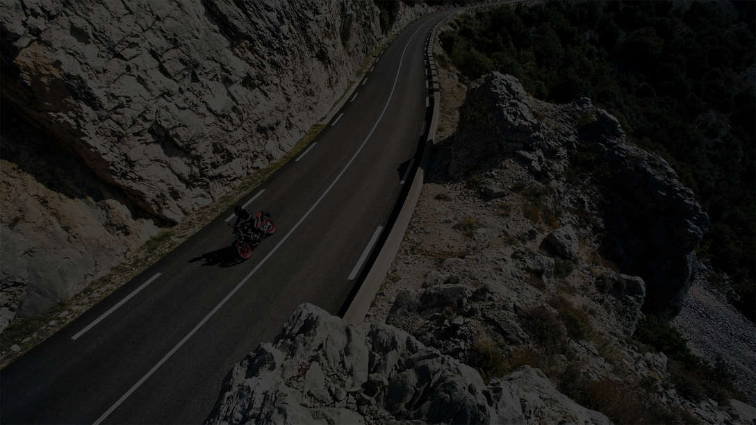 NC750S being ridden on a hillside road