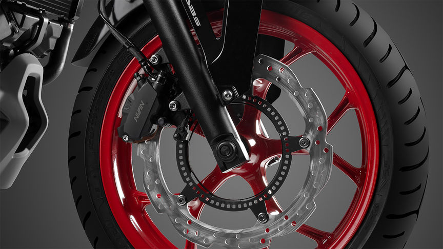 NC750S close up of brakes on red and black wheel