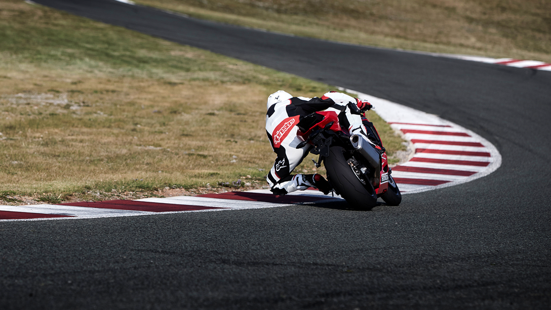 Rear view of Honda CBR1000RR on race track.