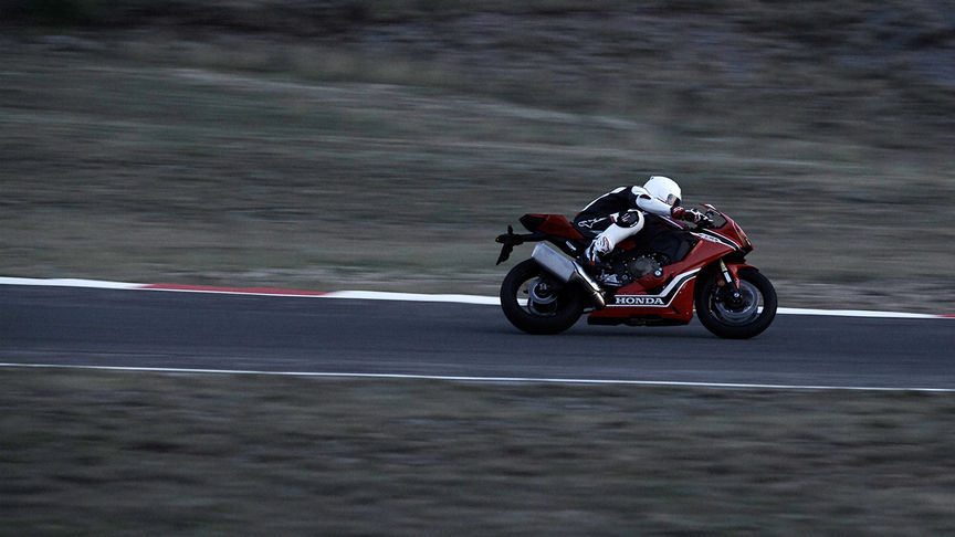 Side facing Honda CBR1000RR rider on track.
