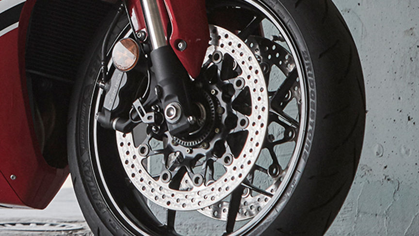 Close up shot of Honda CBR1000RR wheel and brakes.