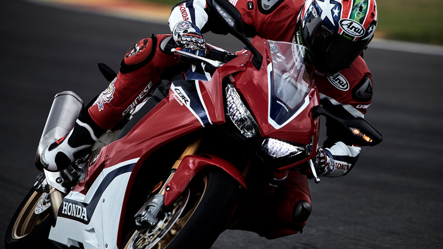 Front three-quarter facing Honda Fireblade with rider.