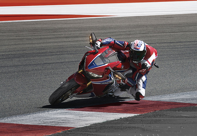 Sideview Honda Fireblade SP on race track.