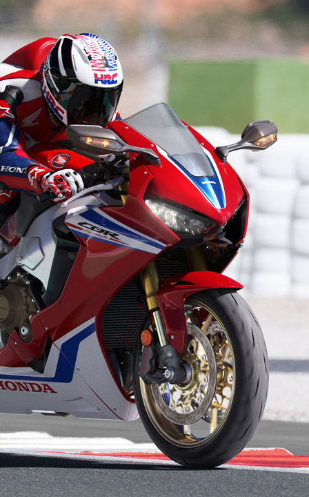Front three-quarter facing Honda Fireblade SP on racetrack.