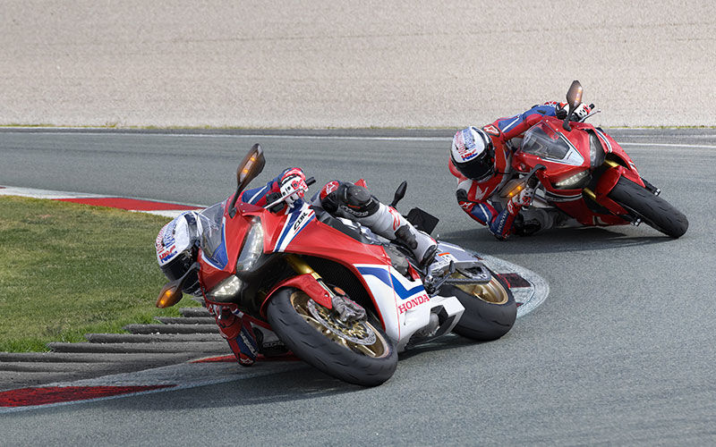Two CBR1000RR Fireblade SP in sharp turns