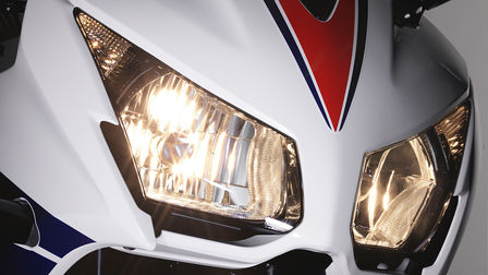 Close up of Honda motorcycle headlights.