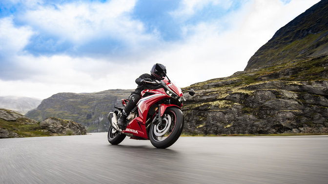 CBR500R, 3-quarter front right side, rolling with rider on mountain road