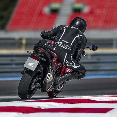 CBR500R, 3-quarter rear right side, rolling with rider on racetrack