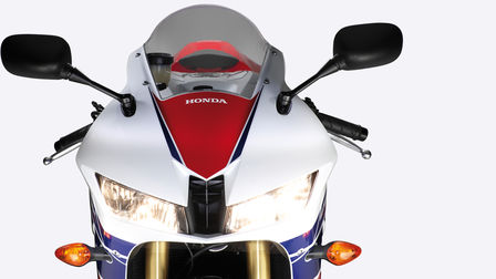 Front-on view of headlights, handlebars, windscreen.
