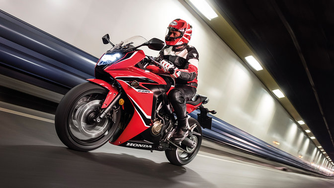 Side shot of rider on Honda CBR650F in a tunnel.
