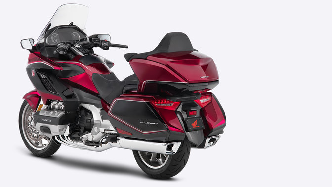 Front three-quarter facing Honda Gold Wing, countryside location.