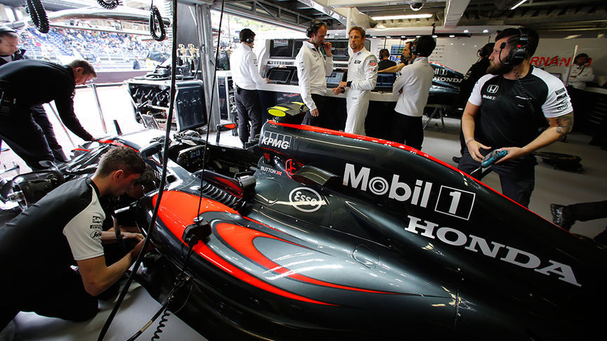 team working on F1 car