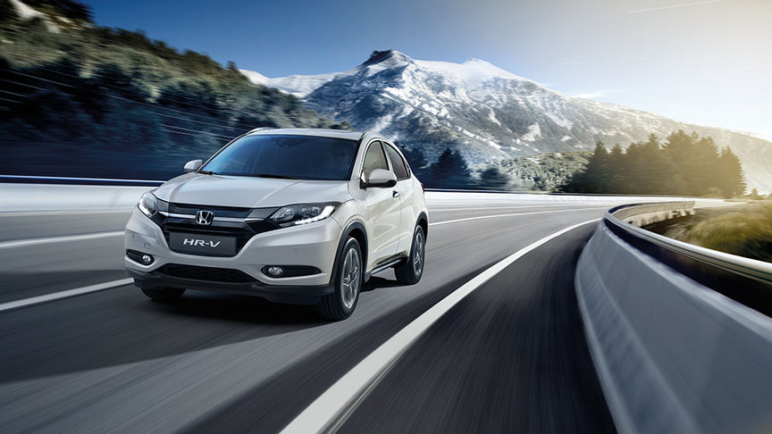 HR-V on scenic road with mountains in the background