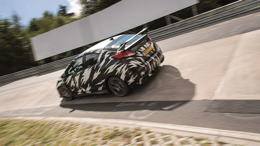 black and white patchy Type R on track