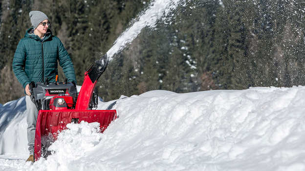 Snowthrower in use by model