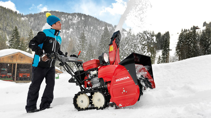 Snowthrower side facing, in use by model.