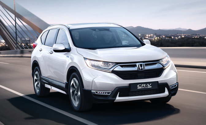 Front three-quarter facing Honda CR-V Hybrid with close up feature and logo.