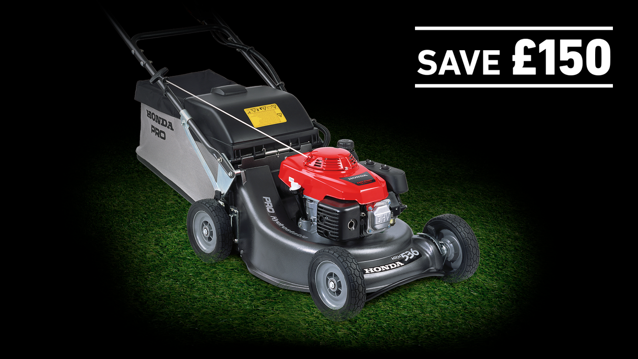 HRH lawnmower on grass in a dark background with save £150