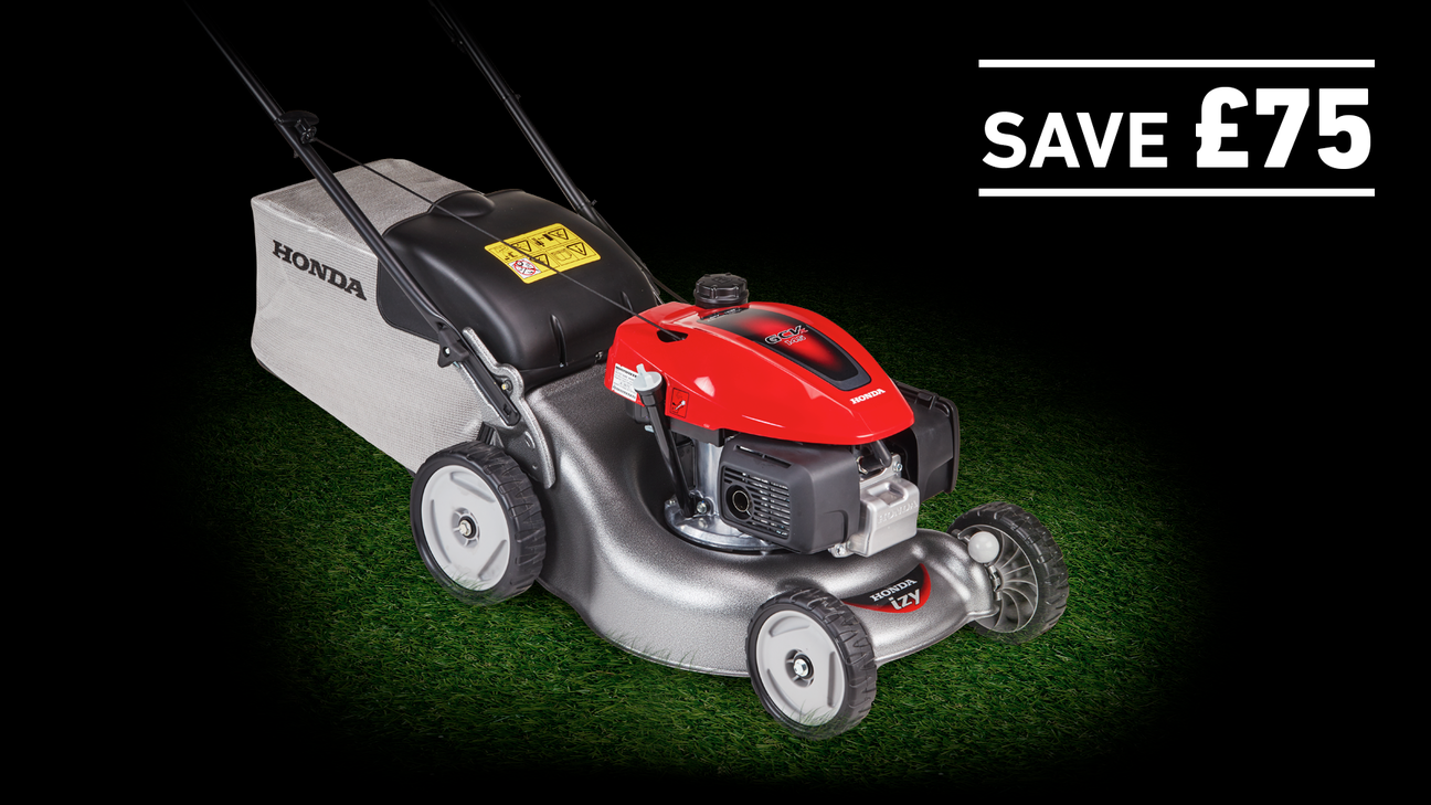 IZY lawnmower on grass in a dark background with save £75
