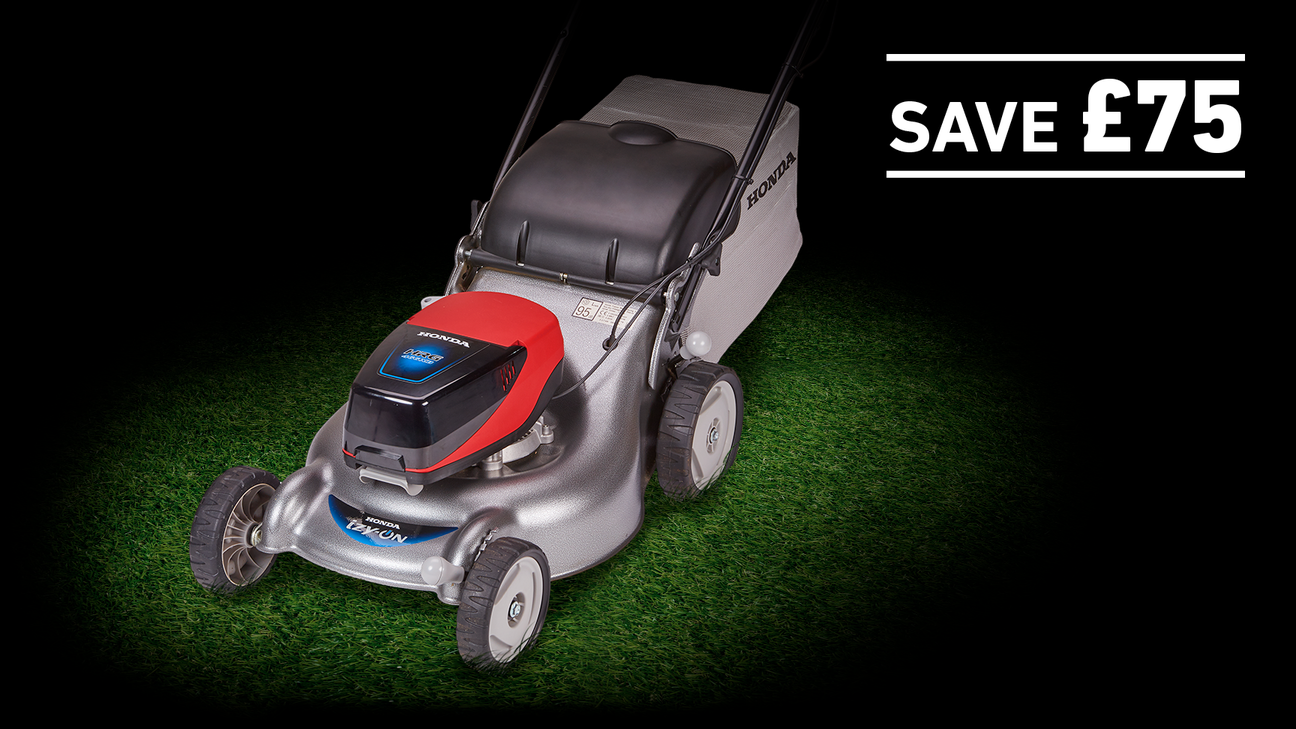 izy-ON lawnmower on grass in a dark background with save £75