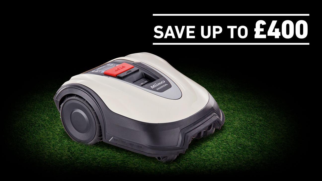 Honda Miimo on grass in a dark background with save £400