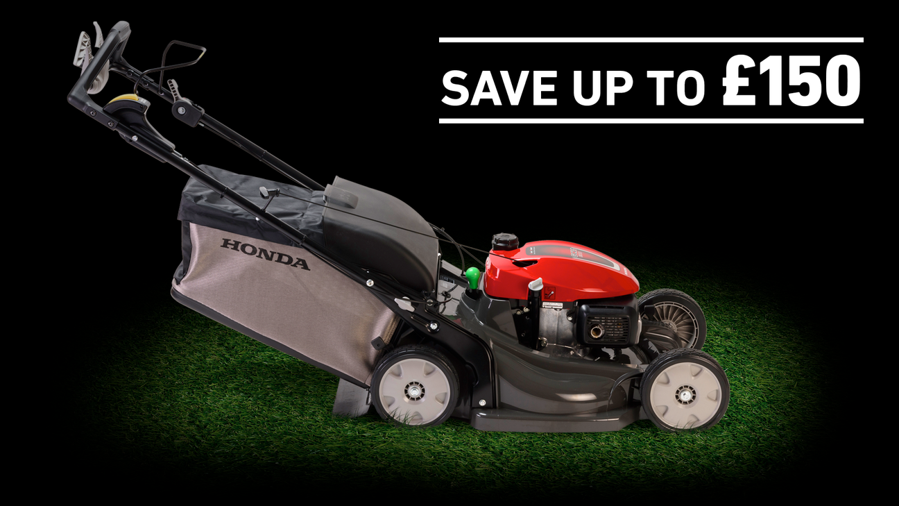 IZY lawnmower  on grass in a dark background with save up to £150