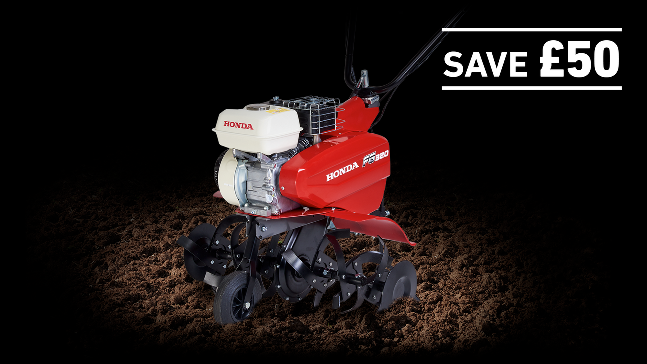 Compact Tiller in soil on a dark background with Save £50
