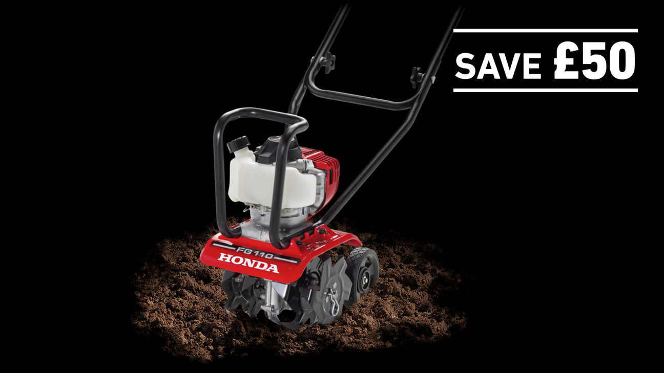 Micro Tiller in soil on a dark background with Save £50