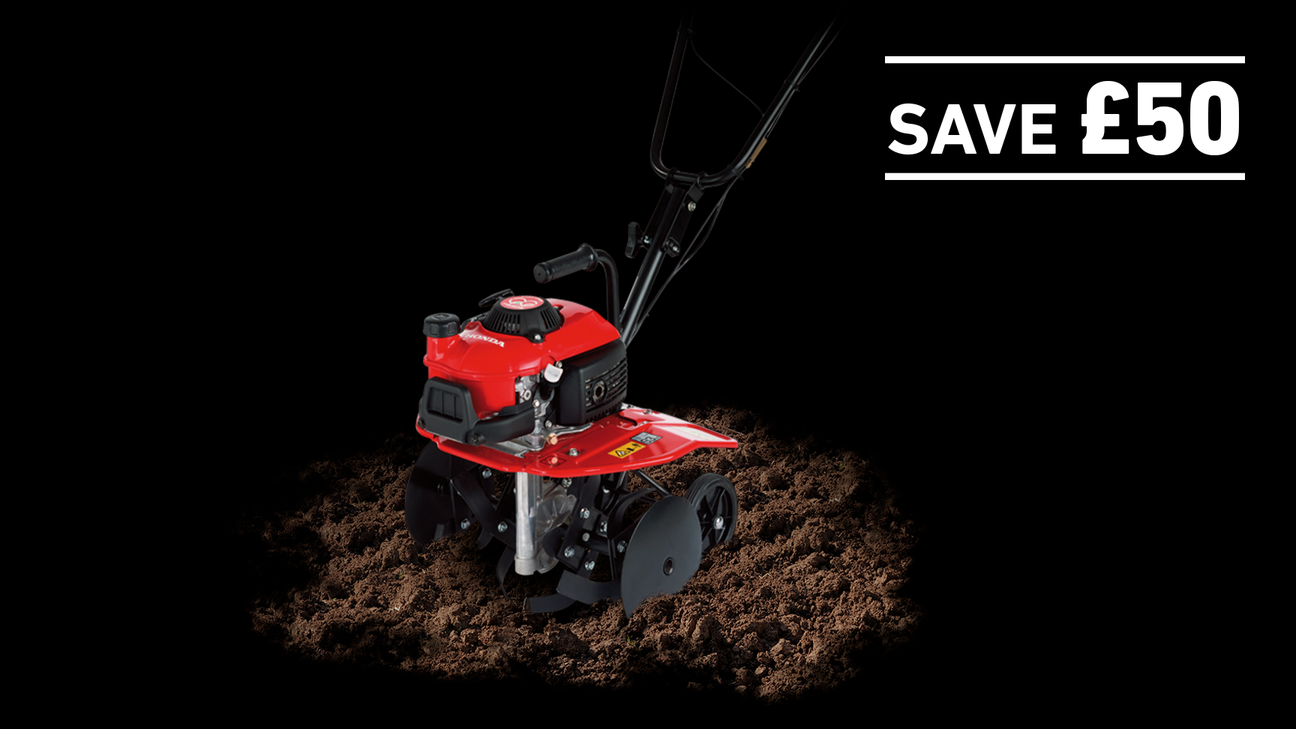 Mini Tiller in soil on a dark background with Save £50