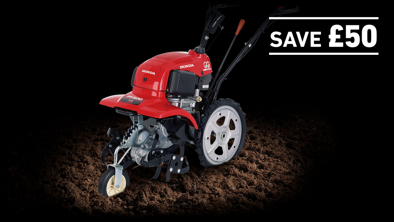 Rotary Tiller in soil on a dark background with Save £50