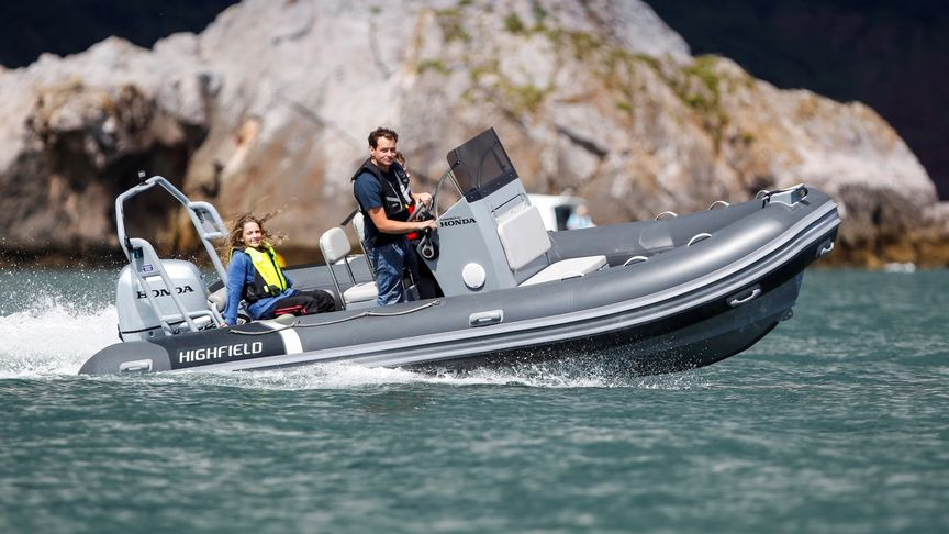 Boat using BF60 engine, being used by models, coastal location.