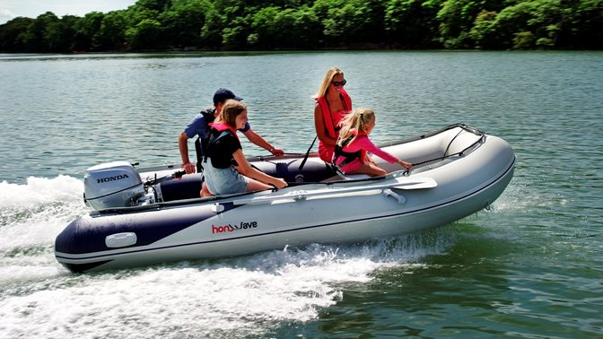 Boat with Honda engine, being used by models, lake location.